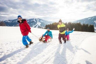 Rodeln im Winterurlaub in Flachau, Salzburger Land